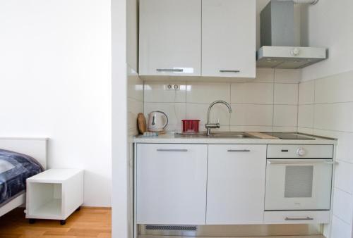 Kuchyň nebo kuchyňský kout v ubytování Apartment Busic in Split