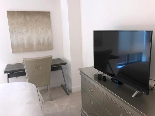 A television and/or entertainment center at Exclusive One Bedroom Apartment in Back Bay, Boston