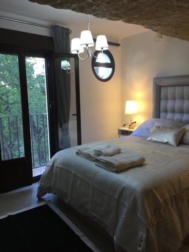 Cama o camas de una habitación en Un Rincón en la Roca