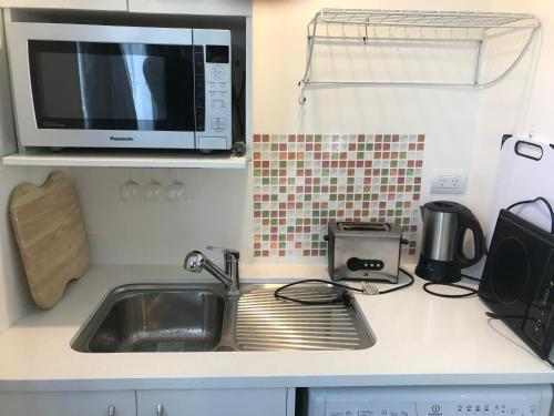 A kitchen or kitchenette at Bucklands Beach Executive Units