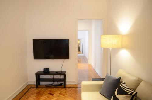 A television and/or entertainment center at Furnas20 Lisbon Flats
