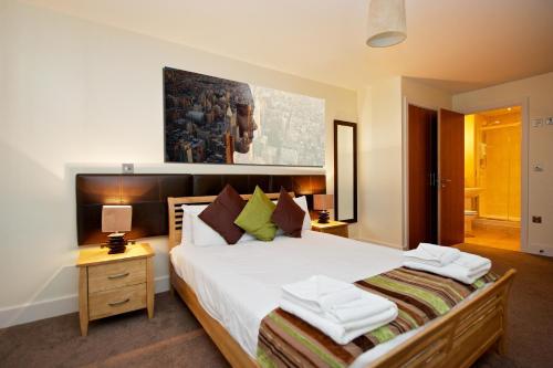 Ένα ή περισσότερα κρεβάτια σε δωμάτιο στο Staycity Aparthotels Birmingham City Centre Arcadian
