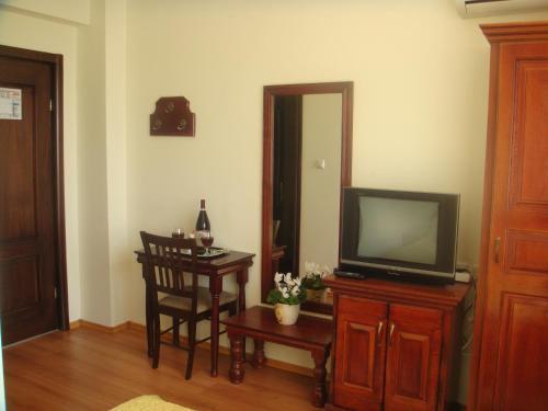 Телевизор и/или развлекательный центр в Vila Corola