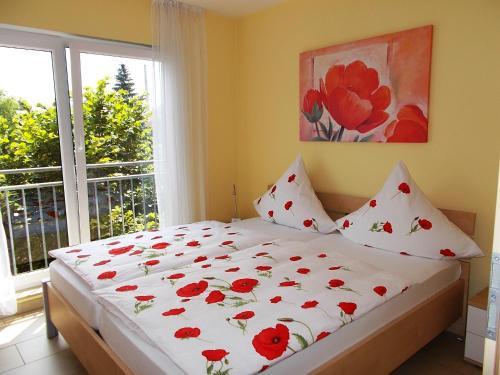 A bed or beds in a room at Ferienwohnungen Uhlemann - nur 15 Minuten bis in die Altstadt