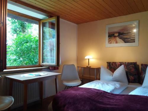 מיטה או מיטות בחדר ב-Gästehaus Linder Ferienwohnungen