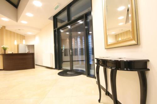 El vestíbulo o zona de recepción de Towarowa Residence