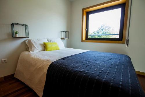 Cama ou camas em um quarto em Casa da Alegria