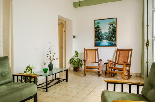 A seating area at My home in Old Havana