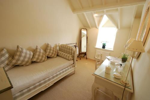 A seating area at The Storehouse | Great Escapes Wales