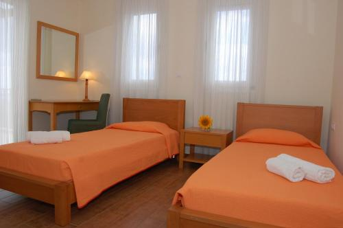 A bed or beds in a room at Gerani Villas
