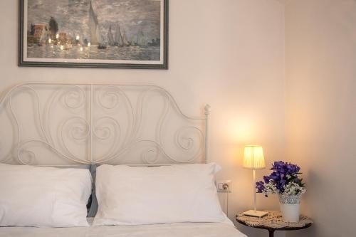 Säng eller sängar i ett rum på Casa nel Borgo Marinaro di Civitanova