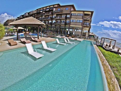 The swimming pool at or close to Barrabali Barra de São Miguel 326