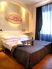 A bed or beds in a room at Hotel Nardizzi Americana