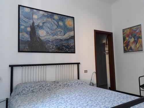Letto o letti in una camera di Cirenaica Apartments