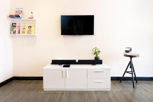 A television and/or entertainment center at Amai Art Home