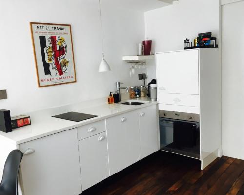 A kitchen or kitchenette at St Honore