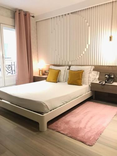 A bed or beds in a room at Abalú Boutique & Design Hotel