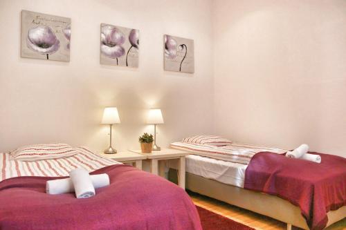 Cama o camas de una habitación en ApartmentsApart