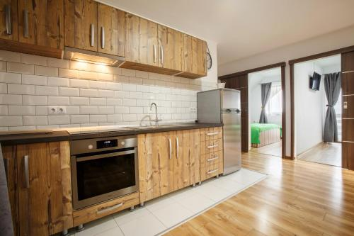 A kitchen or kitchenette at Vila Veve