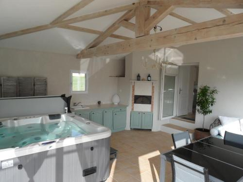 A kitchen or kitchenette at Les Grandes Terres - Gîtes & SPA