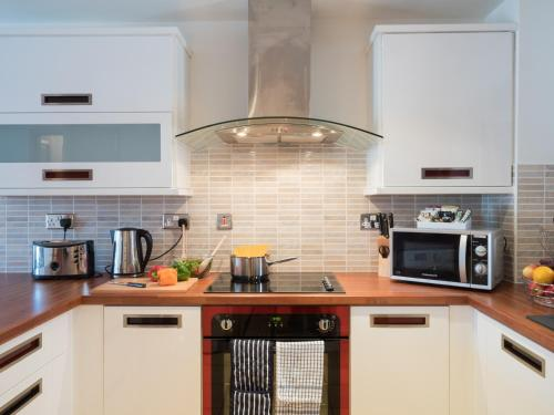 A kitchen or kitchenette at Base Serviced Apartments - Duke Street