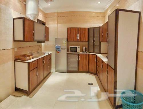 A kitchen or kitchenette at Nadra Furnished Apartments