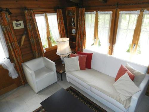 Ein Sitzbereich in der Unterkunft Apartment Abnaki, Chalet