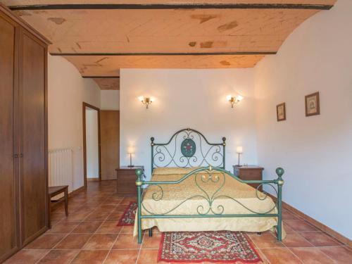 Letto o letti in una camera di Locazione turistica Podere La Madonnina.3