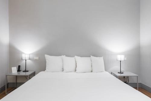 Letto o letti in una camera di Palazzo Cambiaso