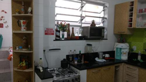 A kitchen or kitchenette at Residencial Recanto dos Pássaros