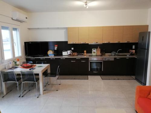 O bucătărie sau chicinetă la Grande Veranda Apartment