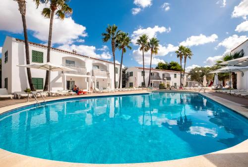 The swimming pool at or near Apartaments Cales de Ponent