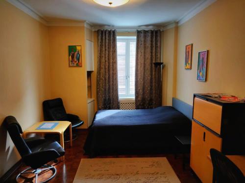 Postel nebo postele na pokoji v ubytování Business style apartment in Helsinki city center