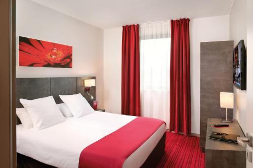 Letto o letti in una camera di Appart'City Confort Grenoble Inovallée