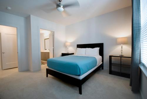 A bed or beds in a room at BCA Furnished Apartments
