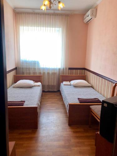Кровать или кровати в номере Мотель Балтика