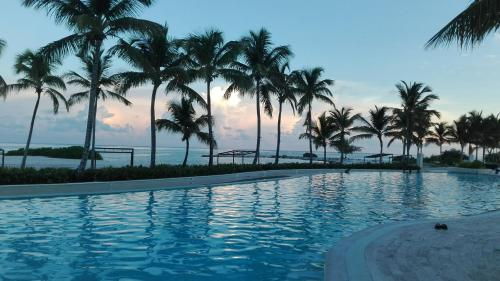 The swimming pool at or near Luxury Beach Penthouse Chef + Cleaning incl - Cap Cana