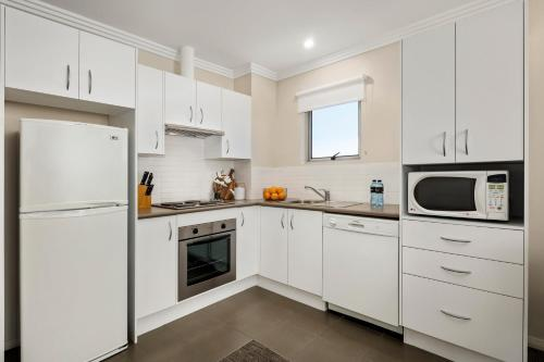 A kitchen or kitchenette at Quest Wollongong