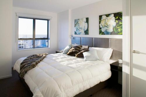 A bed or beds in a room at Waldorf St Martins Apartments Hotel