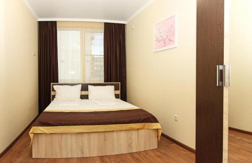 Кровать или кровати в номере Апарт-отель Онегин