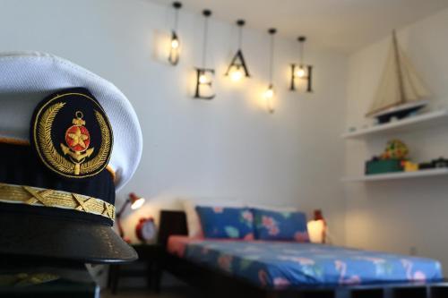 A bed or beds in a room at Life's a Beach Ky Co Summer House