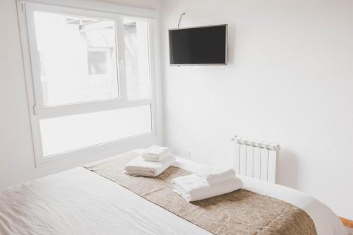 Una cama o camas en una habitación de Alcedro Apart Hotel