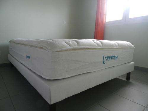 Un ou plusieurs lits dans un hébergement de l'établissement Coco D'Iles