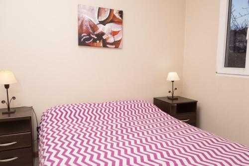Una cama o camas en una habitación de Tronador Bariloche