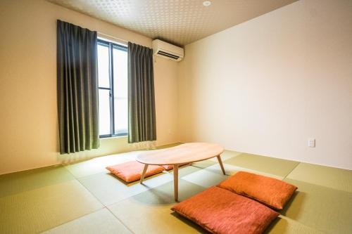 A bed or beds in a room at KYOSTAY Iroha Utsugi