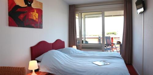 Een bed of bedden in een kamer bij Appartementen Amelander Paradijs