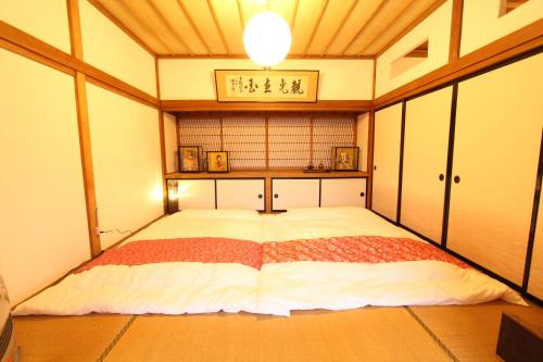 A bed or beds in a room at Fuji Sakura House