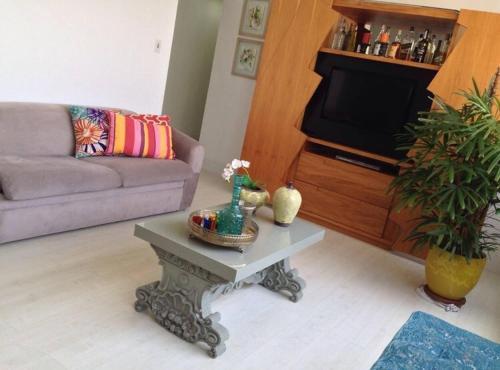 A seating area at Apto 2qtos na PRAIA DO CANTO
