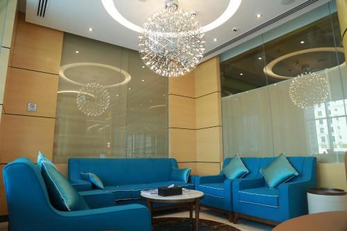 Лобби или стойка регистрации в Tulip Al Barsha Hotel Apartment