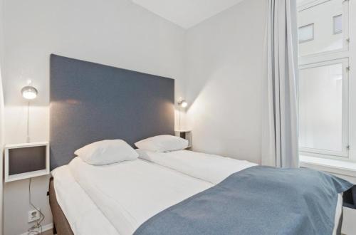 Un ou plusieurs lits dans un hébergement de l'établissement Forenom Serviced Apartments Oslo Vika